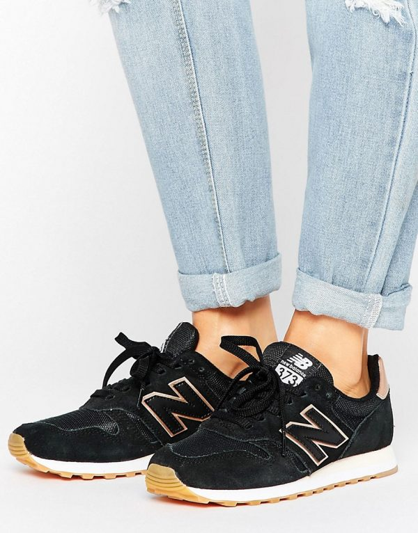 Zapatillas de deporte negras con ribete en dorado rosa 373 de New Balance